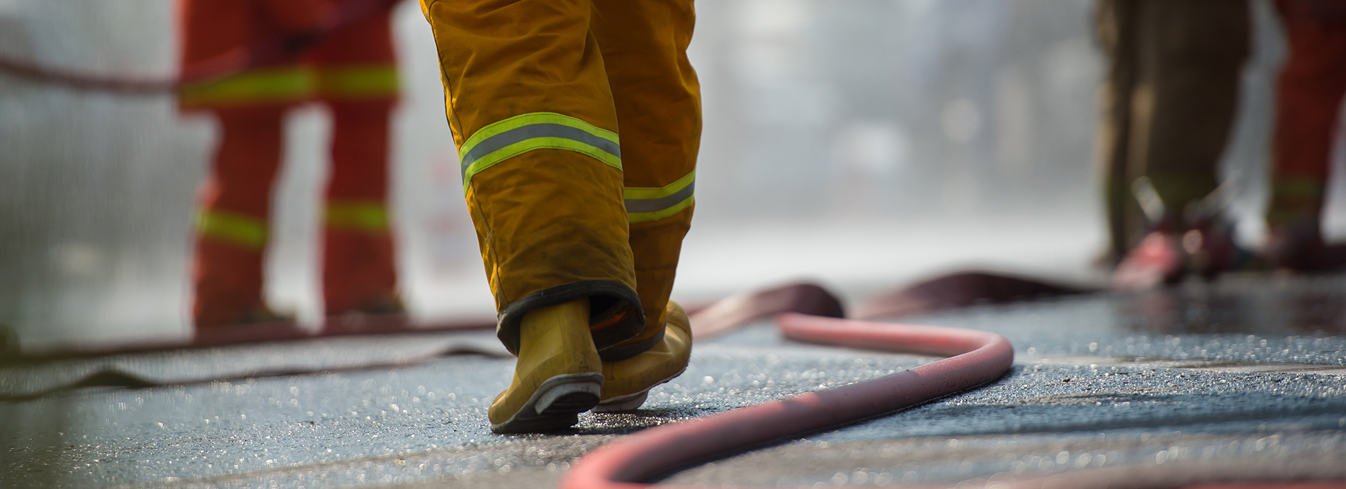fire man walking on road with a pipe