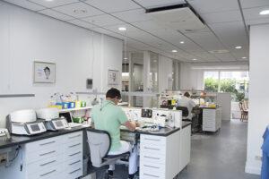 Man working on desk with dental appliances around
